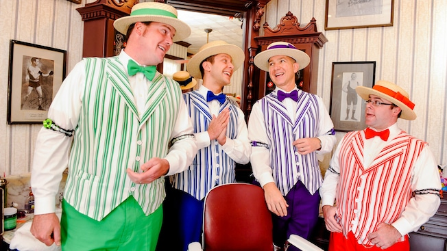 The Dapper Dans barbershop quartet sing in the functioning Harmony Barbershop at Magic Kingdom park.