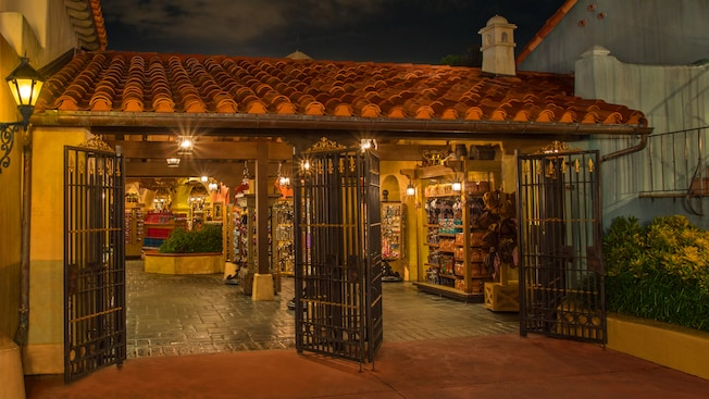 Piñatas, baskets of flowers and colorful pottery in the Plaza Del Sol Caribe Bazaar at Magic Kingdom theme park