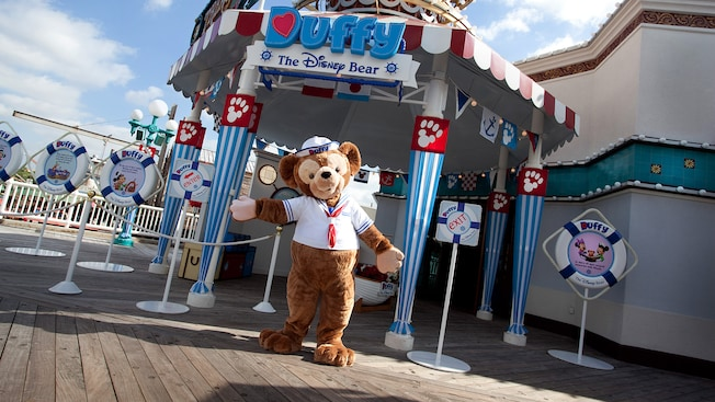 Duffy the Disney Bear opens his arms to welcome Guests to his meet-and-great spot
