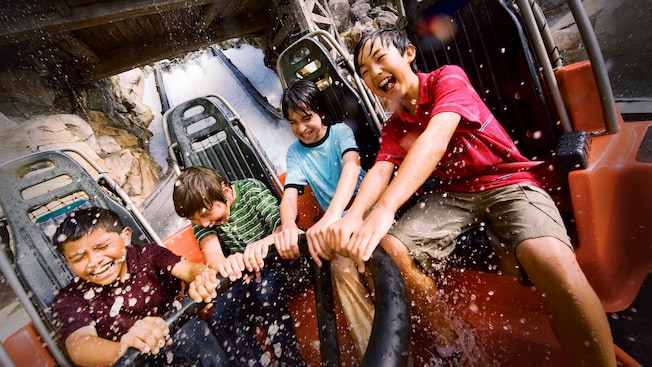 Kids laugh as they get splashed riding Grizzly River Run at Disney California Adventure Park