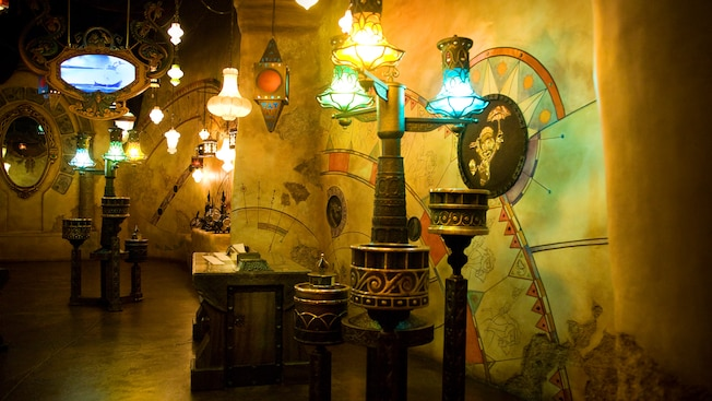 Many lamps hang from the Sorcerer's Workshop ceiling