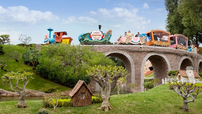 Casey Jr. Circus Train crosses a stone Storybook Land bridge