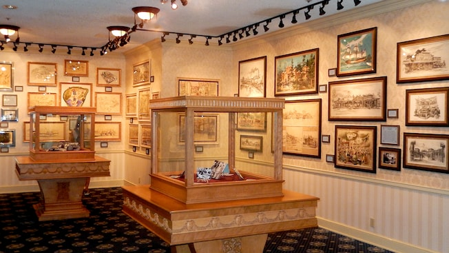Artifacts and paintings are displayed in the Disney Gallery