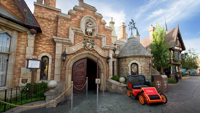 A motorcar waits at the entrance to Mr. Toad's Wild Ride in Disneyland Park