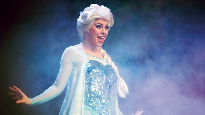 Elsa smiling while performing during For the First Time in Forever: A Frozen Sing-Along Celebration