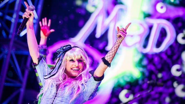 Alice gets the crowd going on stage at the Mad T Party at Disneyland Resort