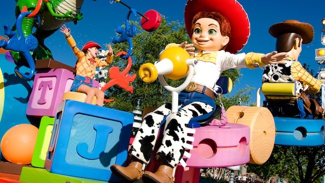 Jessie smiles from Toy Story float in the Pixar Play Parade