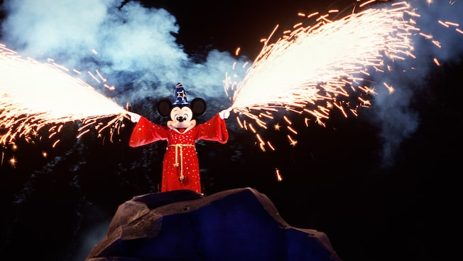 Sorcerer Mickey conjures streams of sparkling pyrotechnics from each hand