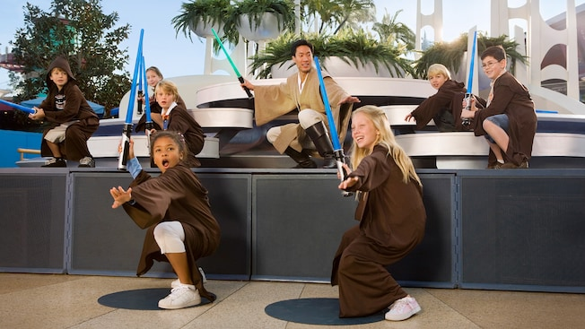 Young kids learn to use lightsabers at Jedi Training Academy at Disneyland Park