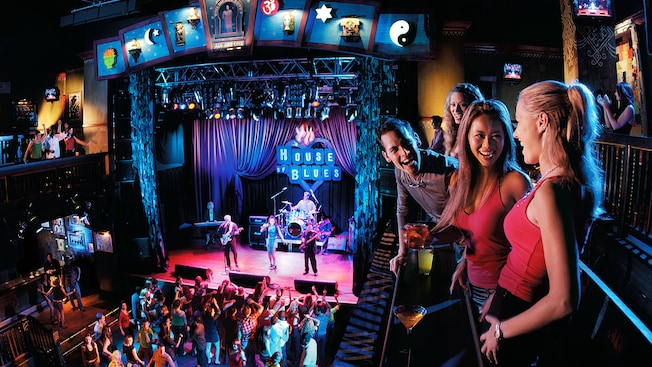 From the balcony, friends enjoy a live performance on the House of Blues Stage