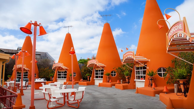 A row of oversize construction cones make up Cozy Cone Motel snack stands in Cars Land
