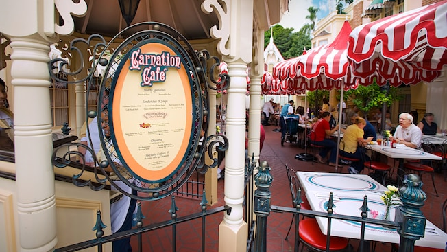 Carnation Cafe menu posted at the restaurant's entrance.