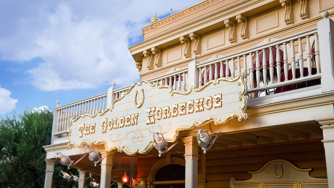 The Golden Horseshoe sign for the theater and dining location in Frontierland