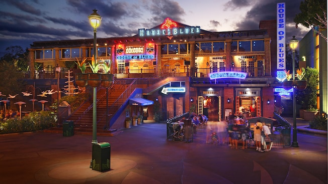 Outdoor patio at House of Blues Restaurant in Anaheim lit by neon signs