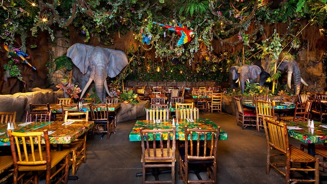 Animated parrot and elephant sculptures fill the jungle-inspired dining area at Rainforest Cafe