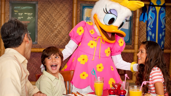 Daisy Duck delights a family with a meal-time visit at Disney's PCH Grill