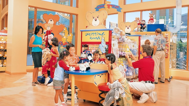 Kids at the Dressing Room station inside the Build-A-Bear Workshop in Downtown Disney District