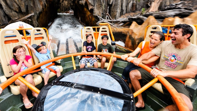 Delighted Guests ride in a circular raft on Kali River Rapids at Disney's Animal Kingdom theme park