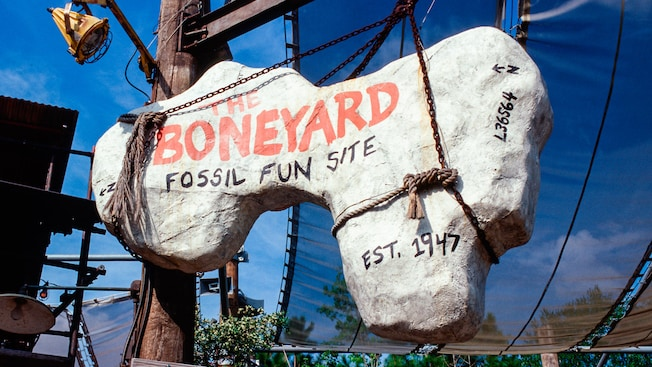 Sign that looks like a fossilized dinosaur bone reads 'The Boneyard Fossil Fun Site, Est. 1947'