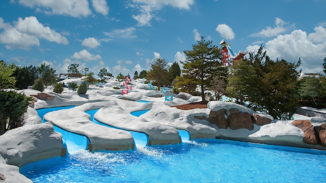 2 waterslides emptying into a pool surrounded by a snowy landscape at Disney's Blizzard Beach