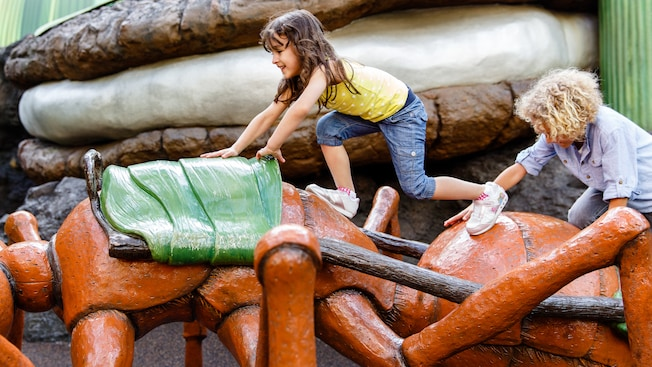 Young boy playing on an oversized prop at 'Honey, I Shrunk the Kids' Movie Set Adventure