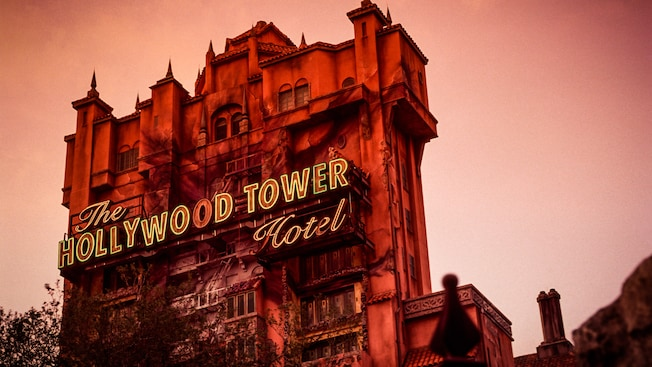The Hollywood Tower Hotel against a midnight-blue sky at night