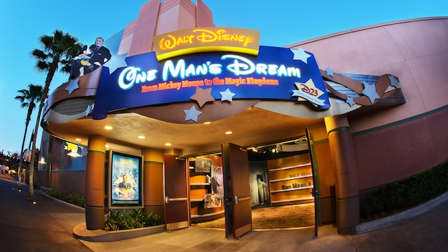 Sign on building that reads 'Walt Disney – One Man's Dream – From Mickey Mouse to Magic Kingdom'