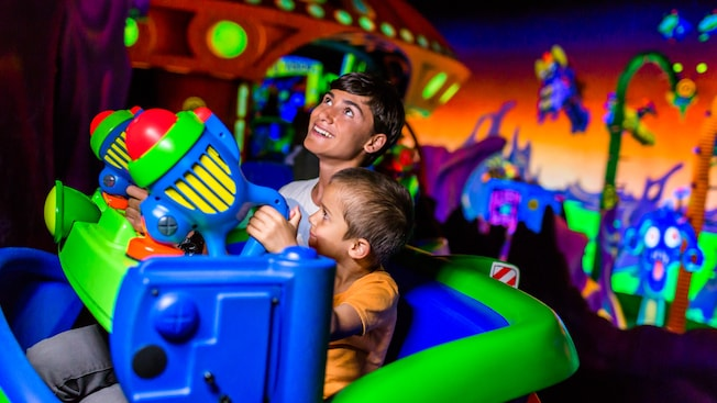 Junior Space Rangers having fun on the Buzz Lightyear's Space Ranger Spin