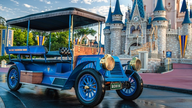 Angled view of a horse-drawn trolley car on Main Street with Cinderella Castle in the background