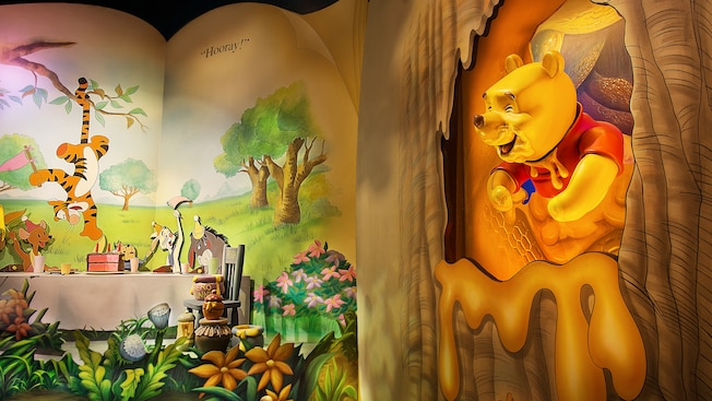 A storybook illustration of a party for Pooh at The Many Adventures of Winnie the Pooh