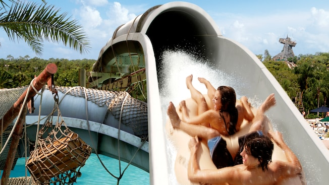A couple sharing a raft slide backwards down Crush 'n' Gusher water coaster