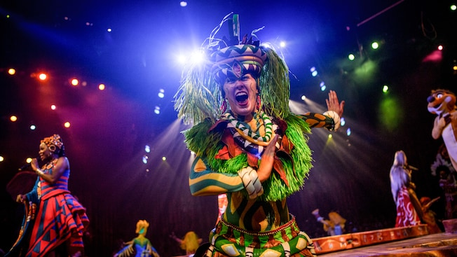 A female costumed performer from Festival of the Lion King sings and dances