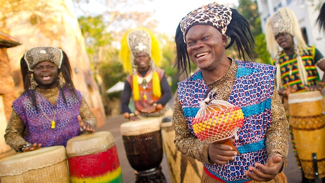 Members of the Tam Tam Drummers of Harambe perform on the streets of Africa