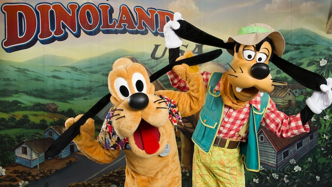 Goofy and Pluto pull on their own ears at Meet Goofy and Pluto in DinoLand USA