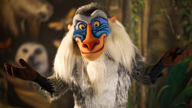 A smiling Rafiki with his arms out-stretched at Meet Rafiki at Rafiki's Planet Watch