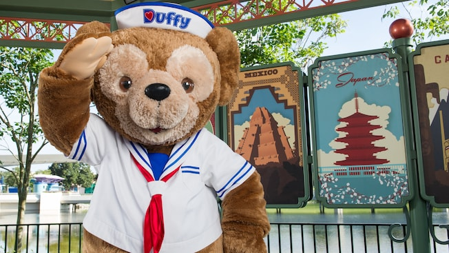 Duffy, wearing a sailor outfit, salutes at Meet Duffy the Disney Bear near Showcase Plaza at Epcot