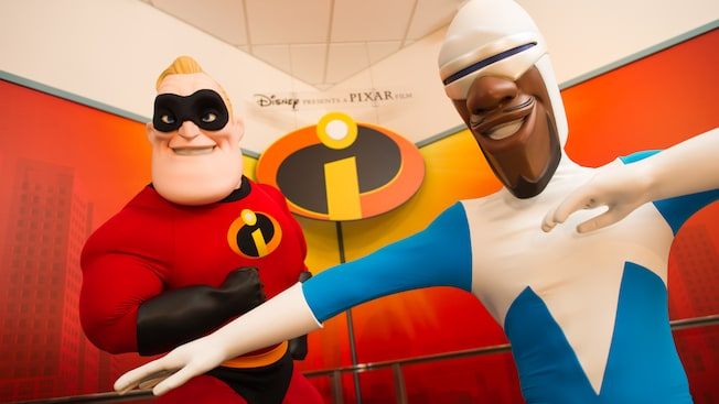 Mr. Incredible and Frozone stand next to each other in Animation Courtyard