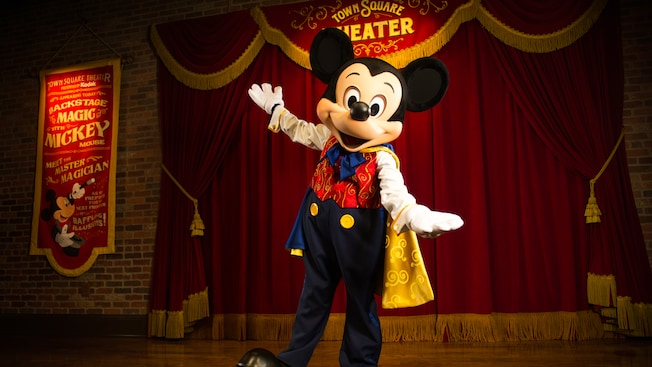 Mickey Mouse waving in front of his wardrobe closet