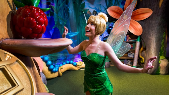 Tinker Bell excitedly looks up into the tree