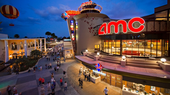 Guests gather outside the AMC Movies at Downtown Disney 24 Theatres at night