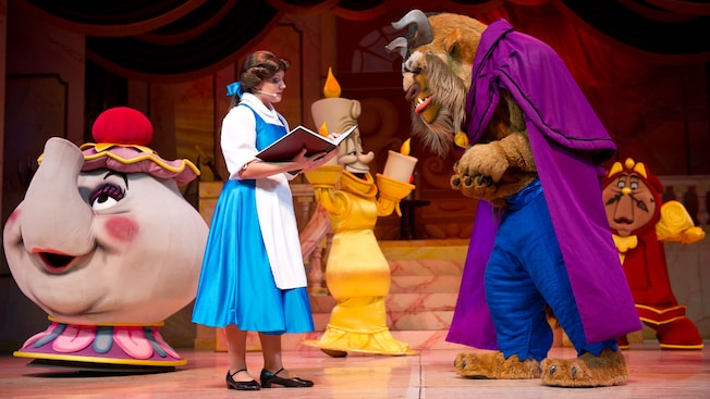 Belle reads to the Beast in a scene from Beauty and the Beast—Live on Stage at Disney's Hollywood Studios