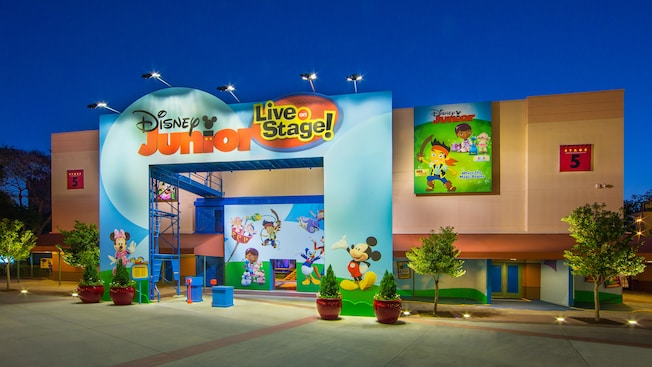 Outside Disney Junior - Live on Stage! theater with paintings of Mickey Mouse and Disney characters