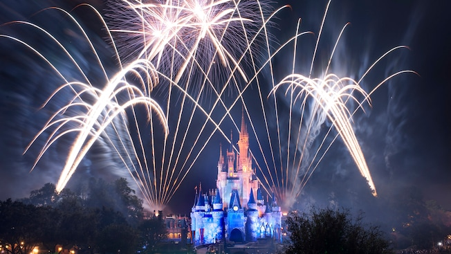 A fantastic fireworks display illuminates the sky above Cinderella Castle at Magic Kingdom park