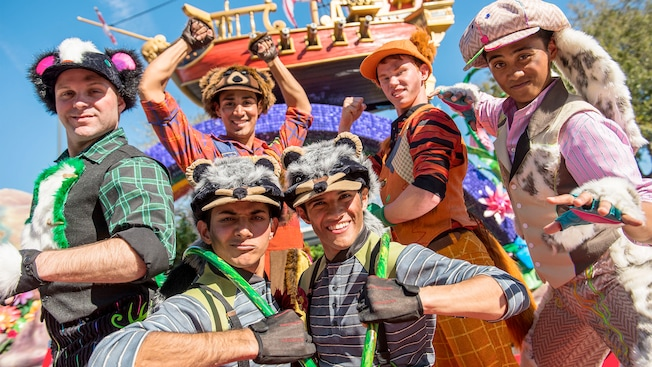 6 Lost Boys from the Disney Festival of Fantasy Parade strike a pose in front of the Jolly Roger Ship