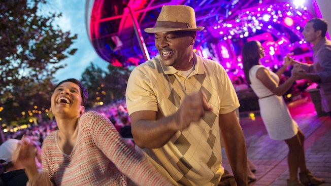 A couple rockin' out on the outdoor dance floor at Flower Power Concert Series at Epcot
