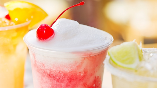 An icy cold Dawa Colada flanked by 2 other specialty drinks at Dawa Bar