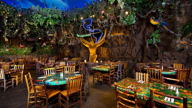 Caricatures of a gorilla, frog, alligator, iguana, leopard and parrot adorn a sign for Rainforest Café