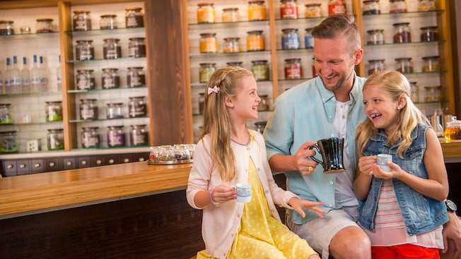 A father and his 2 daughters enjoy a cup of tea inside Joffrey's Tea