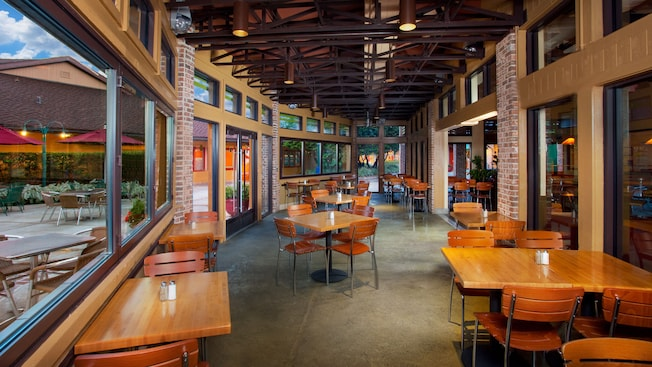 Dining area with windows inside Wolfgang Puck Express at Downtown Disney Marketplace