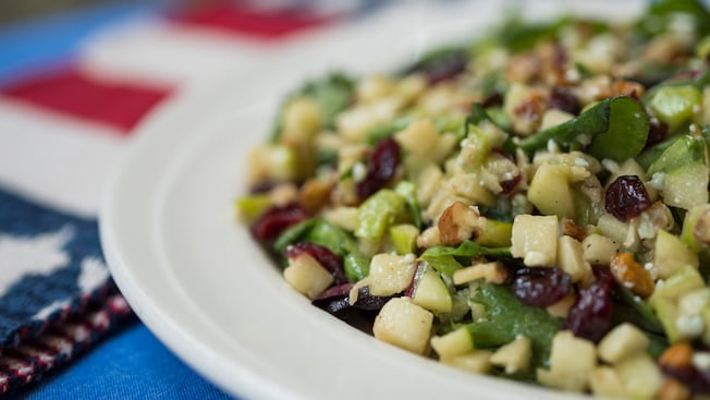Chopped salad with cranberry raisins, pecans, apples, blue cheese and more, and patriotic theming